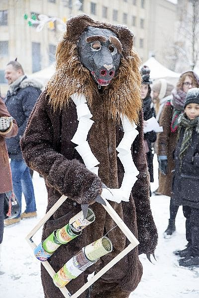 A man celebrates the Shrovetide wearing bears mask